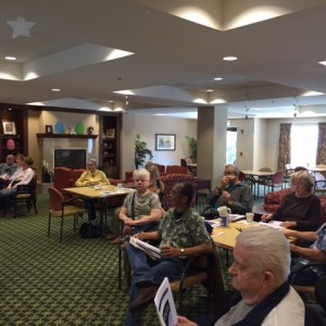 eniors at the Martha Washington listen to the presentation Money Smart for Older Adults. (