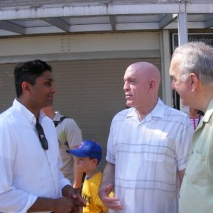 Ald. Ameya Pawar (47th) State Rep. Greg Harris (D-13th) and former 47th Ward Ald. Gene Schulter talk before a ceremony heralding the return of bus service along Lincoln Avenue.  Photo by Patrick Butler